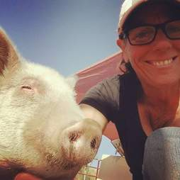 Woman and rescue pig at sanctuary
