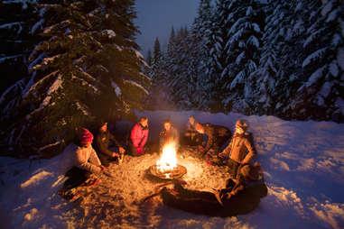 People having a snowshoe bonfire