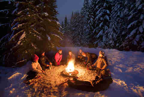 People having a snowshoe bonfire