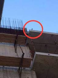 Tiny kitten high up on construction site