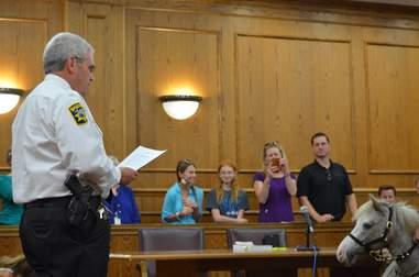 Mini horse sworn in as police deputy