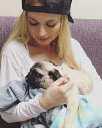 Woman with rescue pug from Iran