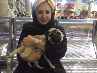 Woman with rescued dog in Iran