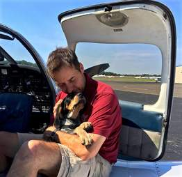 Pilot rescuing shelter dog