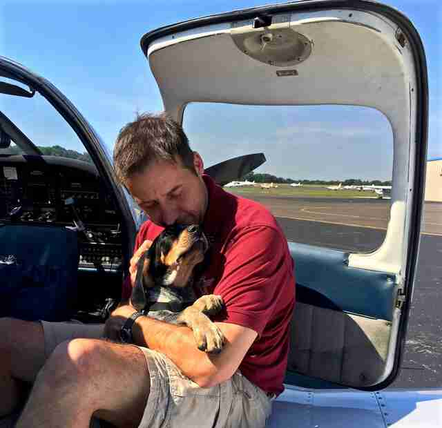 Pilot rescuing shelter dog
