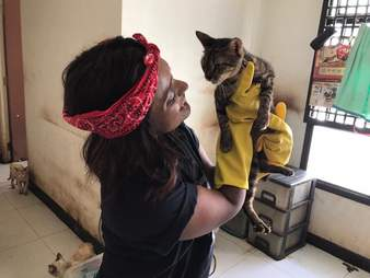 Woman holding rescued cat