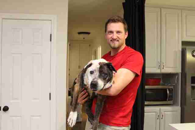 Man holding senior rescue dog