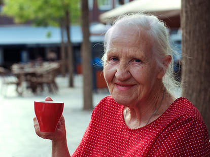old woman drinking coffee