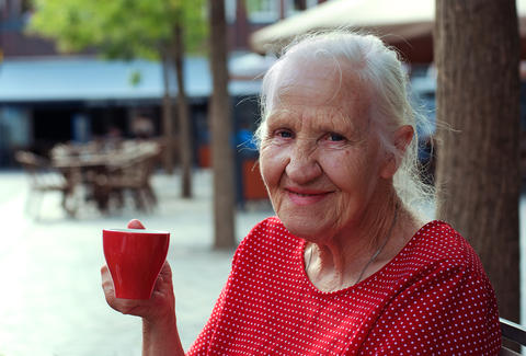 old woman drinking coffee