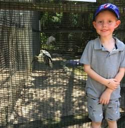 Boy meets bird at sanctuary