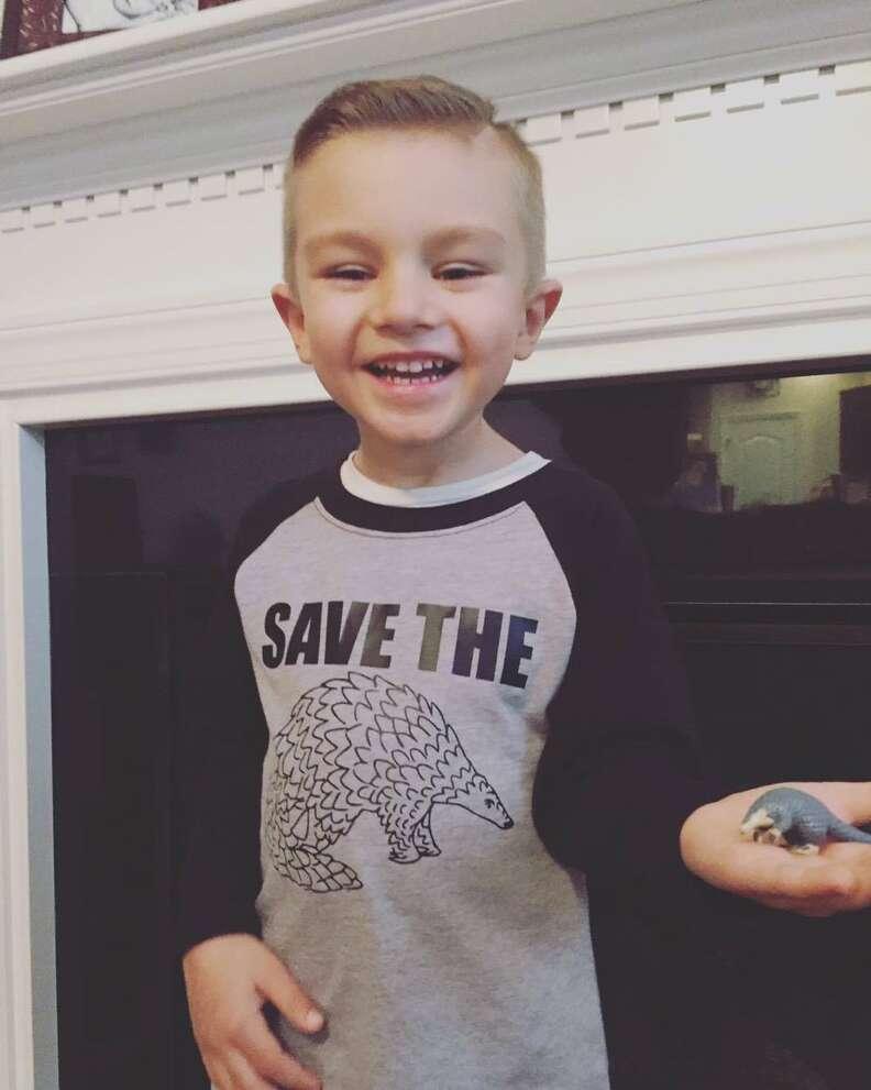 little boy loves pangolins