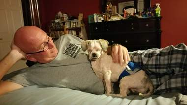 Man relaxing with rescue dog
