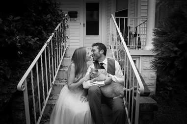 Wedding couple holding cat