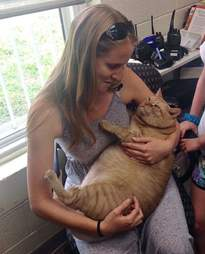 Woman holding rescue cat