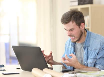 man yelling at computer
