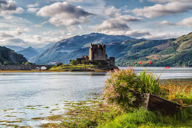 flowers and water in front of the Eilean Donan Castle, Loch Duid, Scotland