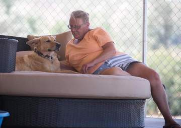 Rescue dog resting with woman