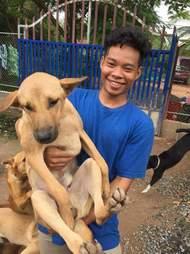 Boy holding rescue dog