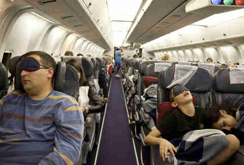 people sleeping on a plane