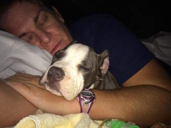 Woman sleeping with puppy