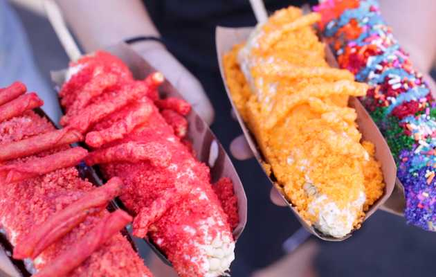 This Mexican Street Corn Is Topped With Junk Food and Rainbow Cheese