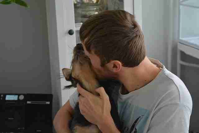 Man kissing rescue dog