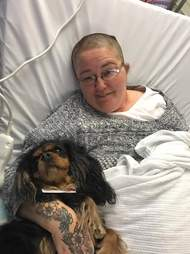 Therapy dog with woman in hospital