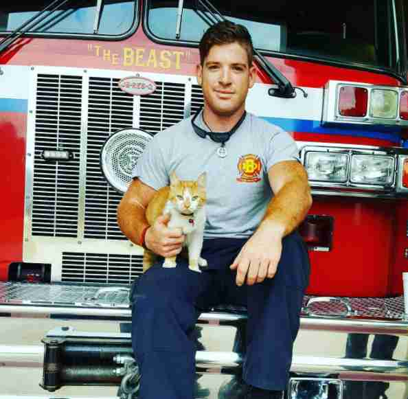 Firefighter holding rescue cat