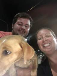 woman and man with rescue dog