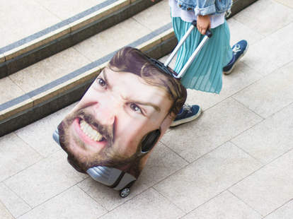 your face on luggage