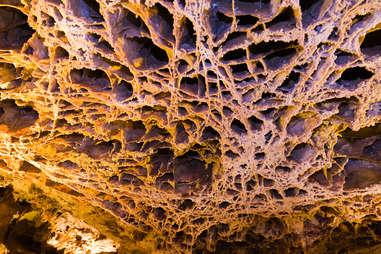 a web-like rock ceiling in a cave