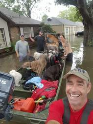 People helping dog in flood