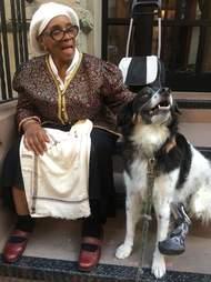 Dog comforting elderly woman