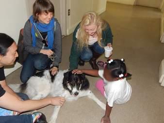 Children with rescue dog