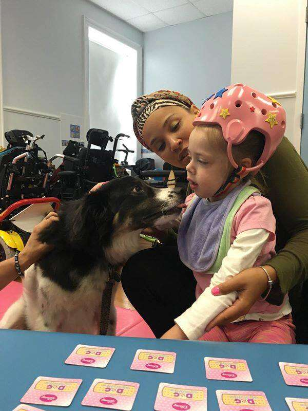 Dog with disabled girl