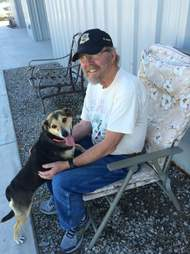 dog hugging his dad
