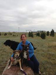 woman holding two dogs