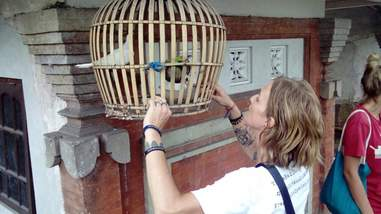 Woman helping caged birds