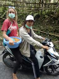 Rescuers on a motorbike