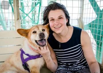dog with woman on ferris wheel