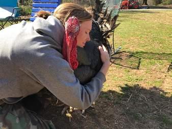 Woman hugging turkey