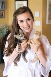 Bride holding kittens