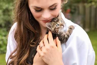 Bride holding kitten