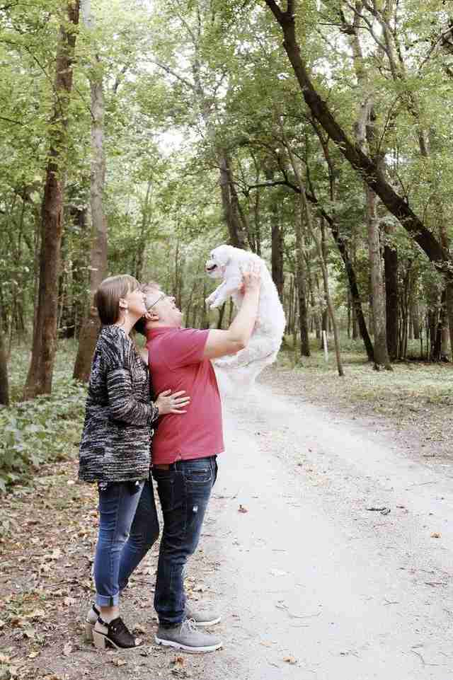 couple does baby photoshoot with dog