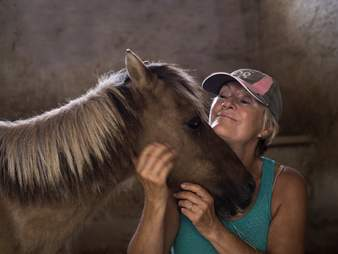 pony with rescuer