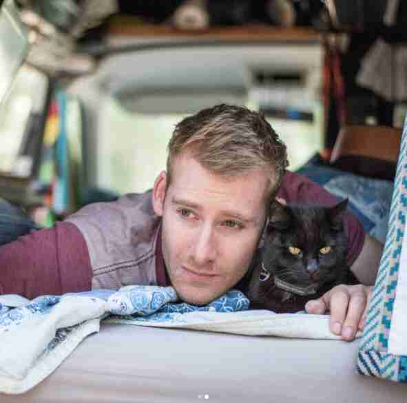 guy and cat travel together