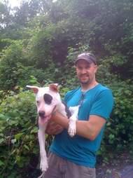 man holding pit bull