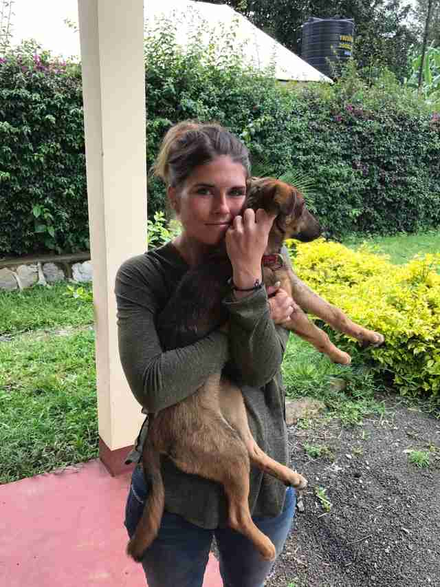 Woman holding rescued dog
