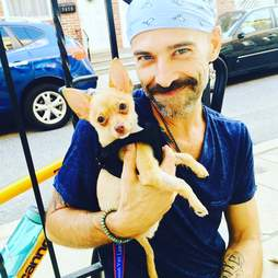 man and puppy heal together