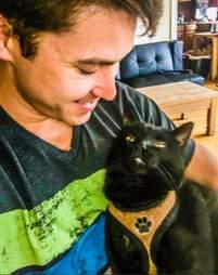 Cat cuddling with dad